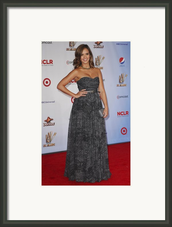 Jessica Alba Wearing A Dress By Michael Framed Print By Everett