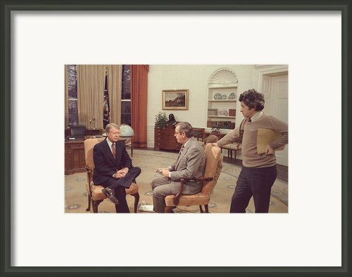 Jimmy Carter Prepares For An Interview Framed Print By Everett