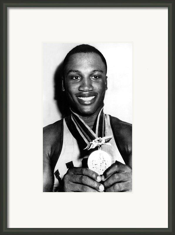 Joe Frazier Holding Olympic Heavyweight Framed Print By Everett