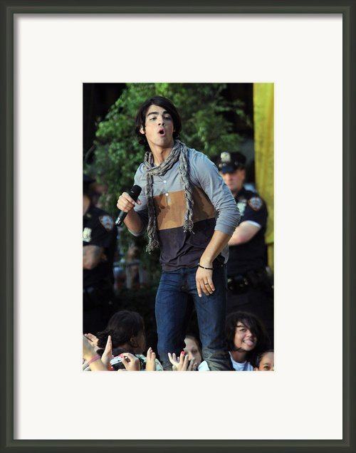 Joe Jonas On Stage For The Jonas Framed Print By Everett