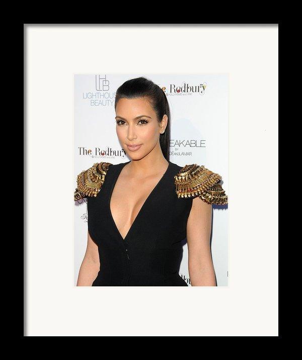 Kim Kardashian Wearing An Alexander Framed Print By Everett