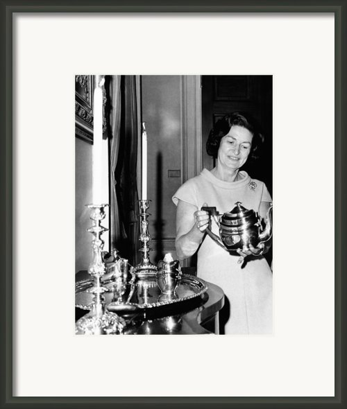 Lady Bird Johnson Holds A Silver Teapot Framed Print By Everett