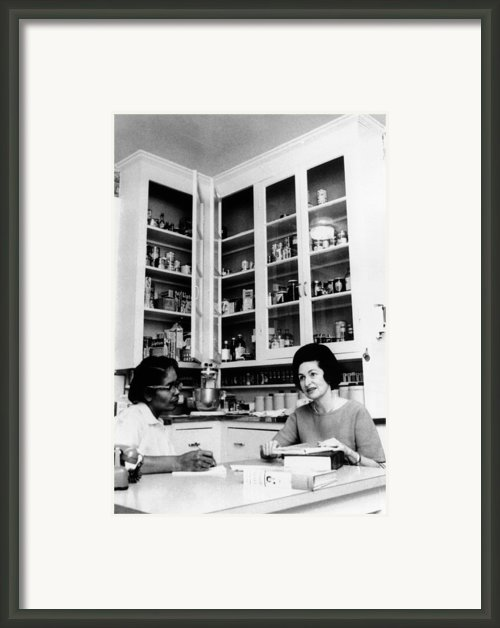 Lady Bird Johnson, In The Kitchen Framed Print By Everett