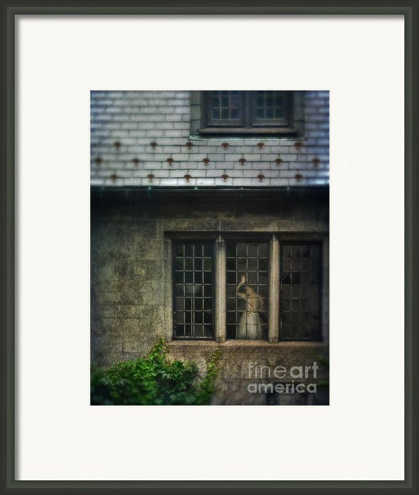 Lady By Window Of Tudor Mansion Framed Print By Jill Battaglia