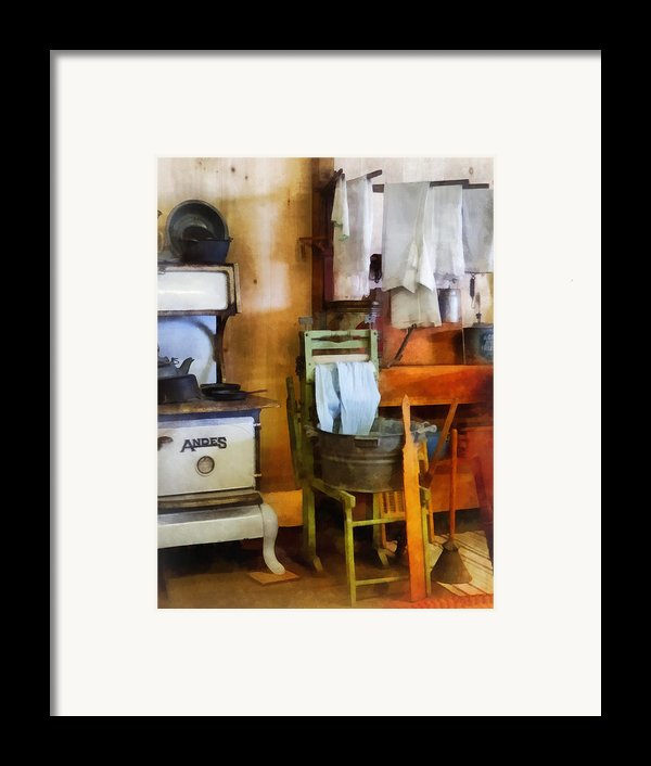 Laundry Drying In Kitchen Framed Print By Susan Savad