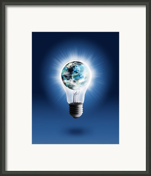 Light Bulb With Globe Framed Print By Setsiri Silapasuwanchai
