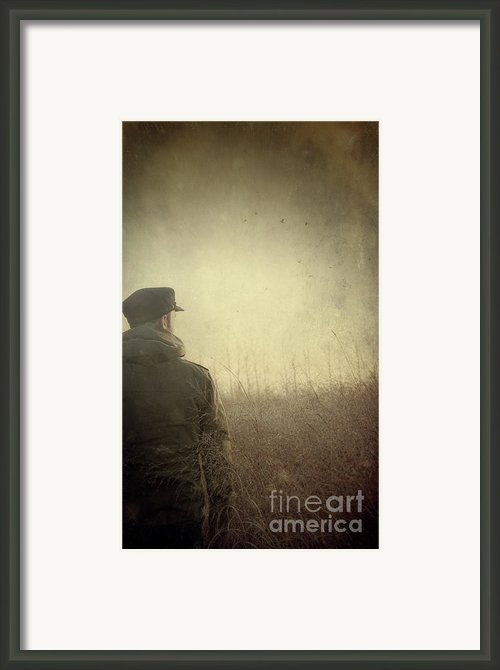 Man Alone In Autumn Field Framed Print By Sandra Cunningham