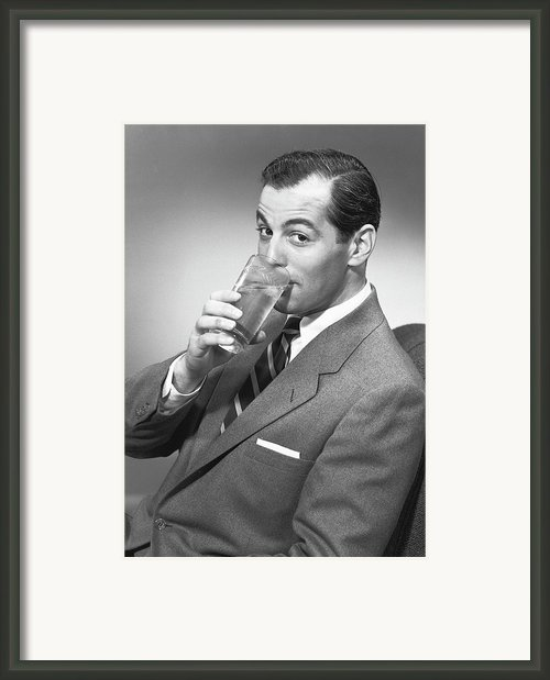 Man Drinking Water From Glass, Posing In Studio, (b&w), Portrait Framed Print By George Marks
