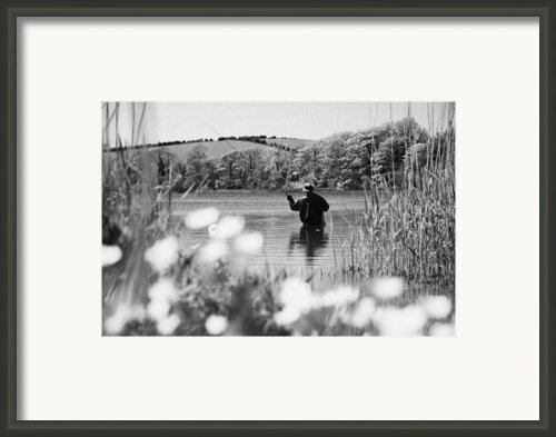 Man Flyfishing On Lake In Ireland Framed Print By Joe Fox