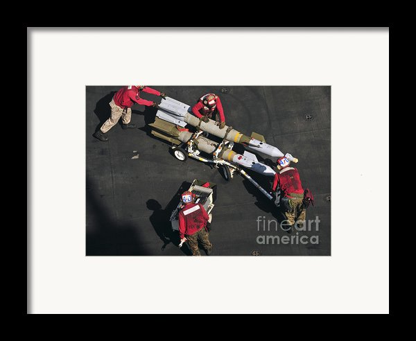 Marines Push Pordnance Into Place Framed Print By Stocktrek Images