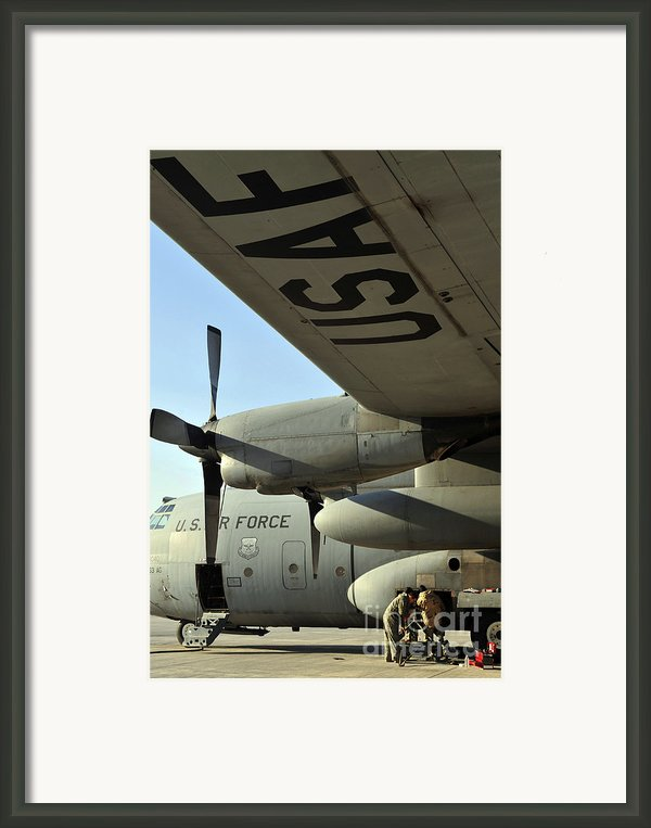 Mechanics Change An Auxiliary Power Framed Print By Stocktrek Images