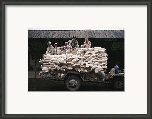 Men Sit On Bags Of Flour Framed Print By Justin Guariglia