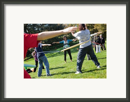 Michelle Obama Hula Hoops With Children Framed Print By Everett
