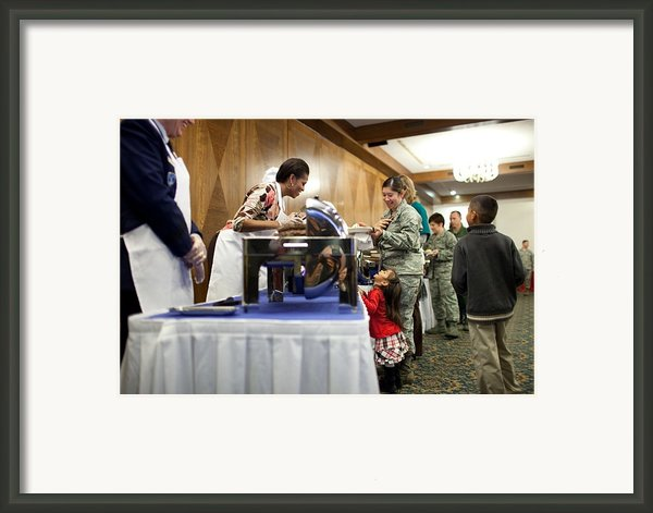 Michelle Obama Talks With A Little Girl Framed Print By Everett