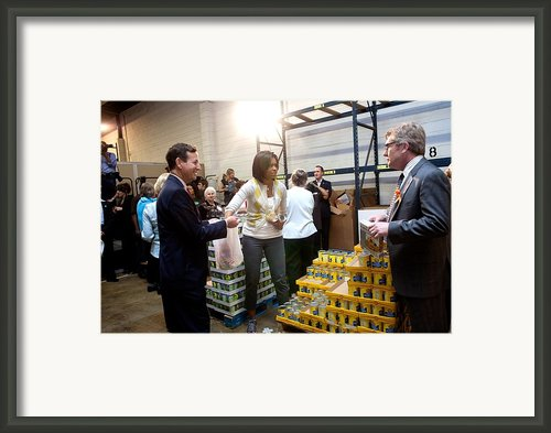 Michelle Obama Volunteers For Feeding Framed Print By Everett