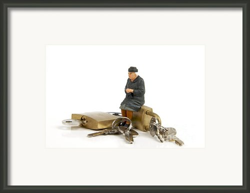 Miniature Figurines Of Elderly Sitting On Padlocks Framed Print By Bernard Jaubert
