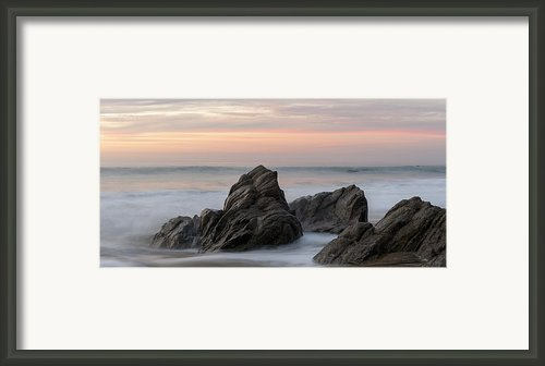Mist Surrounding Rocks In The Ocean Framed Print By Keith Levit