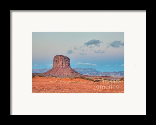 Mitchell Butte In Monument Valley Framed Print By Clarence Holmes