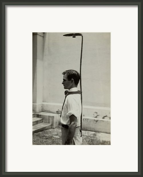 Model Wears A Slave Bell Rack, A Used Framed Print By Everett
