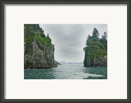 Monoliths In Aialik Cape On A Foggy Framed Print By James Forte