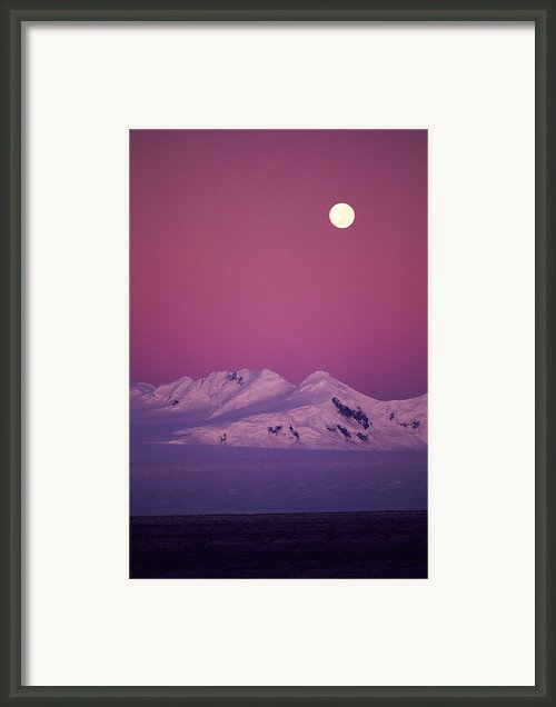 Moonrise Over Snowy Mountain Framed Print By Stockbyte