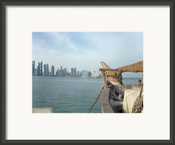 Moored Dhow And Doha Framed Print By Paul Cowan