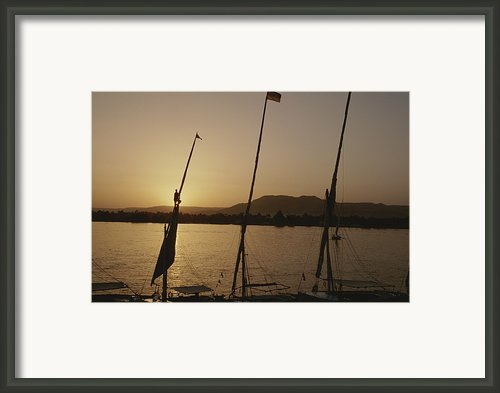 Moored Feluccas On The Nile River Framed Print By Kenneth Garrett