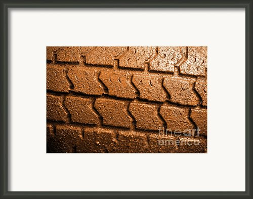 Muddy Tire Framed Print By Carlos Caetano