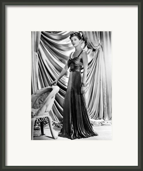 Myrna Loy Wearing Green And Yellow Gold Framed Print By Everett