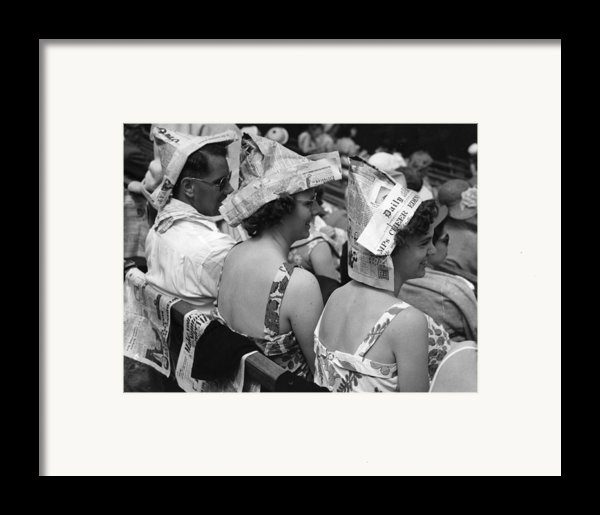 Newspaper Hats Framed Print By Fox Photos