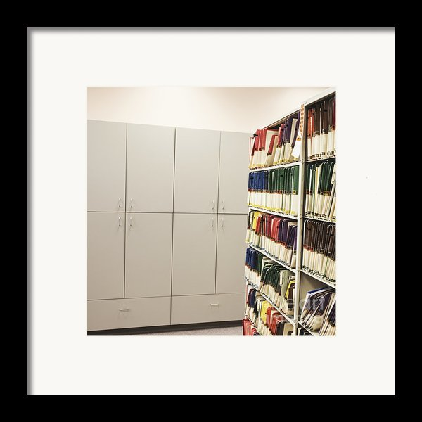 Office Cabinets And Colorful Files Framed Print By Jetta Productions, Inc