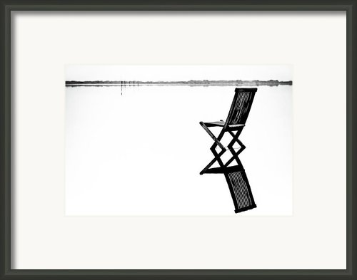 Old Chair In Calm Water Framed Print By Gert Lavsen