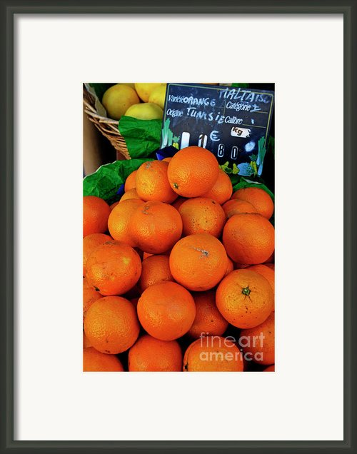 Oranges Displayed In A Grocery Shop Framed Print By Sami Sarkis