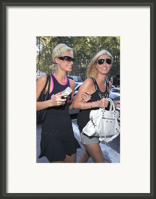 Paris Hilton, Nikki Hilton Carrying Framed Print By Everett