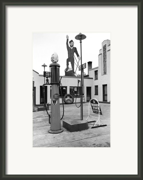 Paul Bunyan Atop Gas Station, Bemidji Framed Print By Everett