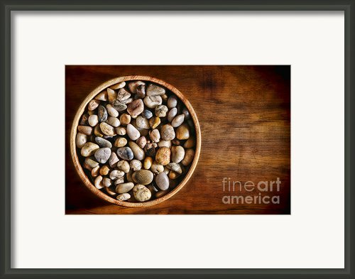 Pebbles In Wood Bowl Framed Print By Olivier Le Queinec