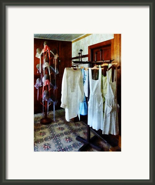 Pinafores And Bonnets In General Store Framed Print By Susan Savad