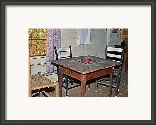 Playing Checkers Framed Print By Susan Leggett