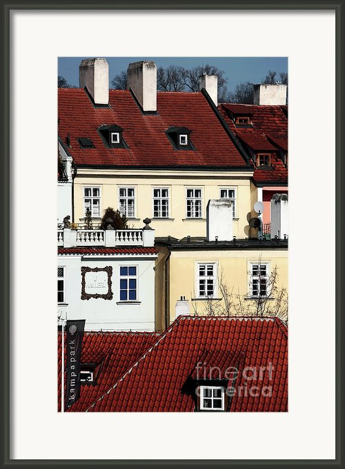 Prague Houses Framed Print By John Rizzuto