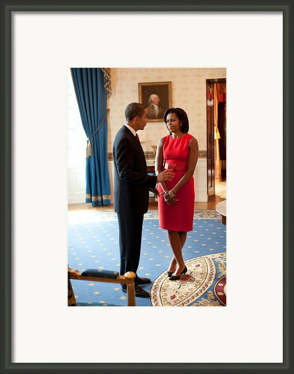 President And Michelle Obama Talk Framed Print By Everett