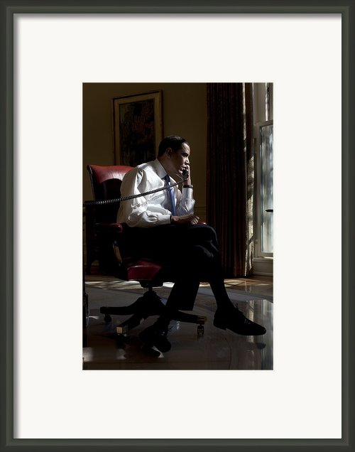 President Barack Obama At His Oval Framed Print By Everett