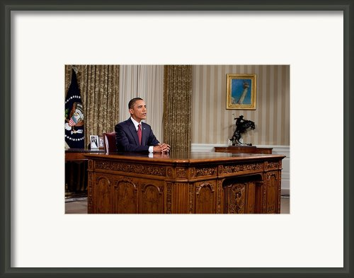 President Barack Obama Delivers An Framed Print By Everett