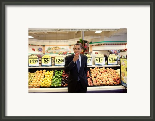 President Barack Obama Eats A Peach Framed Print By Everett