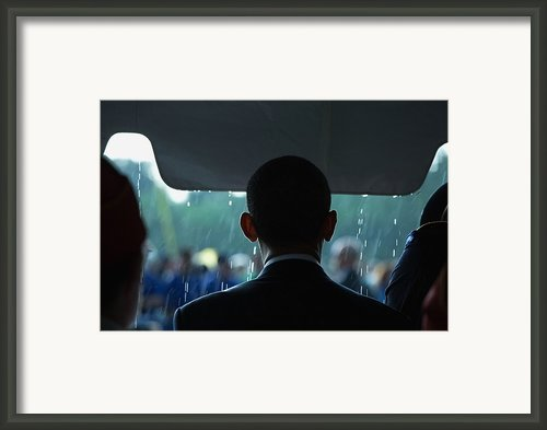 President Barack Obama In The Rain Framed Print By Everett