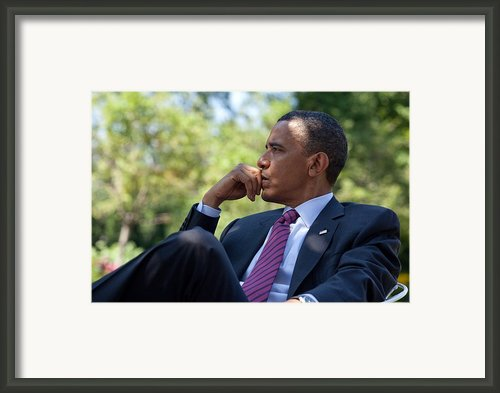 President Barack Obama Is Briefed Framed Print By Everett
