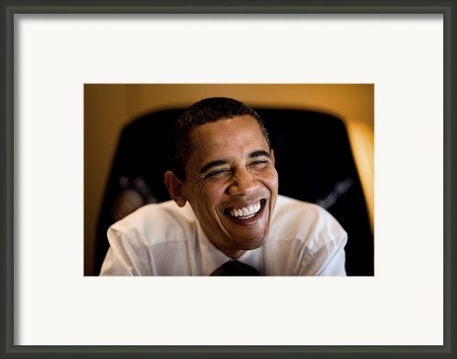 President Barack Obama Laughs During An Framed Print By Everett