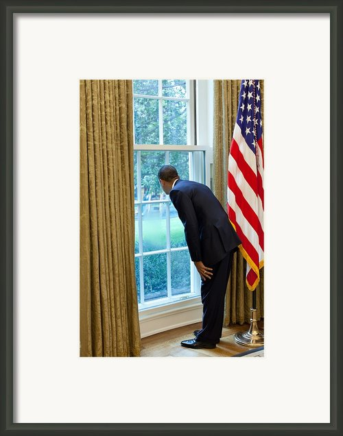 President Barack Obama Looks Framed Print By Everett