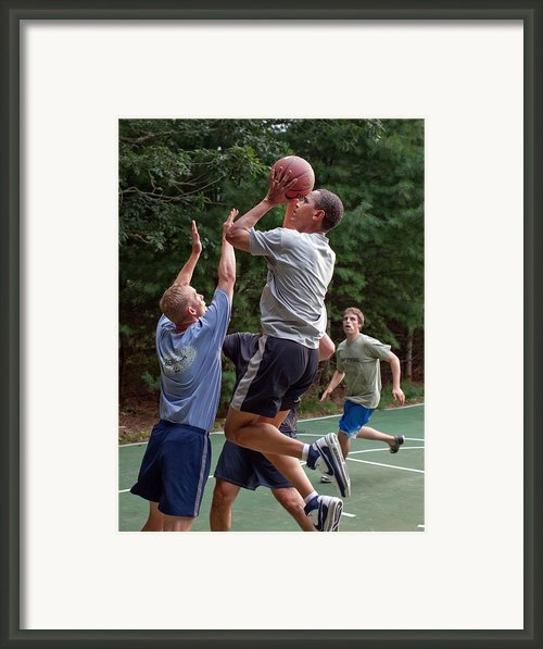 President Barack Obama Plays Basketball Framed Print By Everett