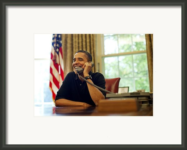 President Barack Obama Talks By Phone Framed Print By Everett