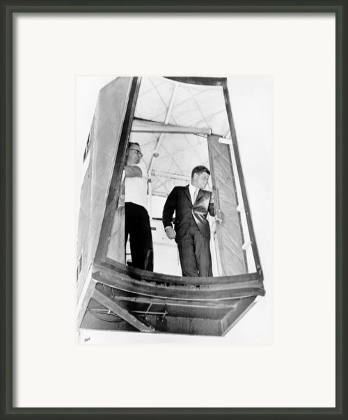 President John F. Kennedy Riding Framed Print By Everett